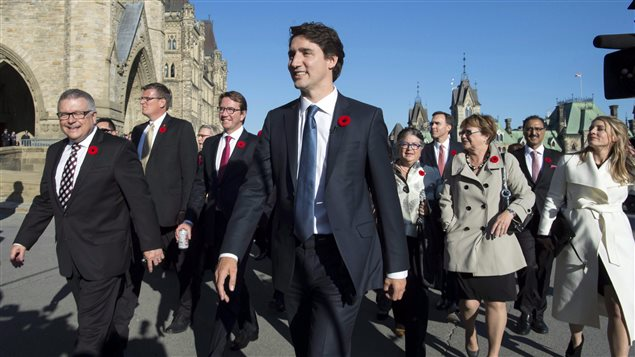 Prime Minister Justin Trudeau arrives on Parliament Hill with his newly sworn in cabinet ministers, in Ottawa on Wednesday, Nov. 4, 2015.