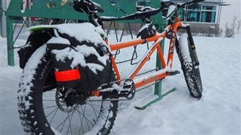 Some cyclists but bigger and sometimes studded tires on their bikes for better traction in winter.