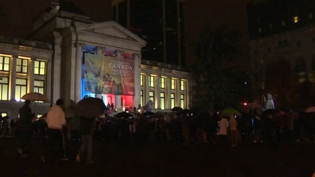 UP to 1,000 people braved pouring rain in Vancouver to show up in front of the art gallery to show solidarity with France. The colours of the french flag iluminated the entrance