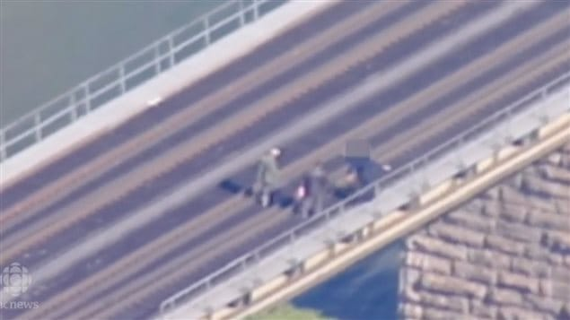 Surveillance footage of two men on a railway bridge. Raed Jaser and Chiheb Esseghaier were found guilty on eight terror related charges after they planned to plant bombs to derail a passenger train on the bridge in Ontario. Cooperation between intelligence services enabled authorities to foil the plot.