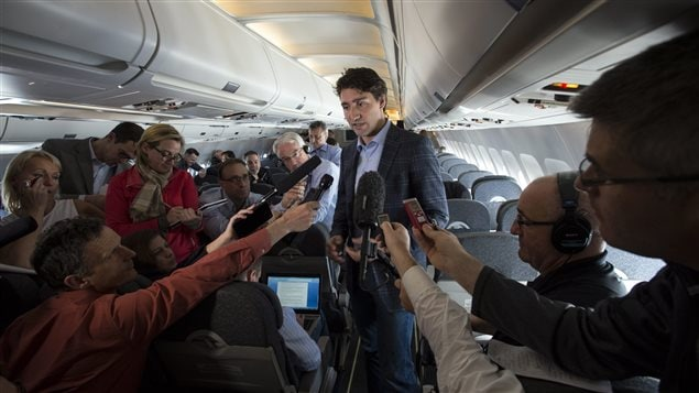 Prime Minister Justin Trudeau speaks to reporters while flying from Antalya, Turkey to Manila, Philippines on Tuesday, Nov. 17, 2015, to attend the APEC Summit.