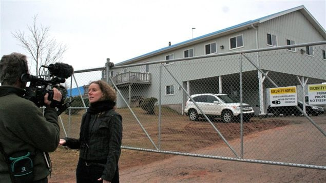 Lucy Sharratt, Coordinator, Canadian Biotechnology Action Network being interviewed in ront of the Aqua Bounty research and development facility in Prince Edward Island in 2013