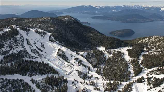 This photo released by Tourism British Columbia shows an aerial view of Cypress Mountain including the half pipe and ski cross/snowboard cross track with views of the ocean and Howe Sound in the background.