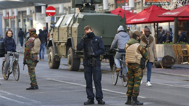 Belgian soldiers and police patrol in central Brussels as police searched the area during a continued high level of security following the recent deadly Paris attacks, Belgium, November 23, 2015.