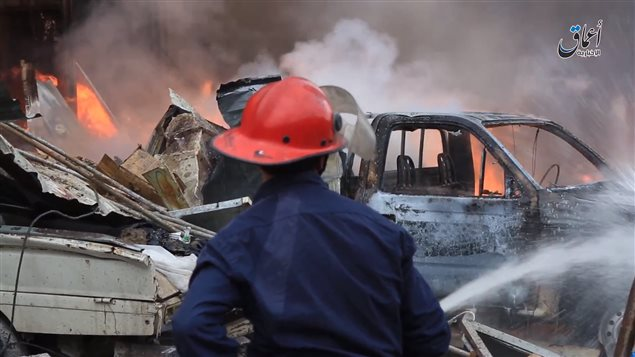 A still image from an ISIS video posted online showing what is alleged to be the aftermath of a Canadian airstrike in northern Iraq on Nov. 19, 2015. The bombardment hit an ISIS bomb-making factory in Mosul, but local news agencies allege it also killed 10 civilian workers at a nearby dairy and ice cream factory. (Courtesy of Airwars.org)