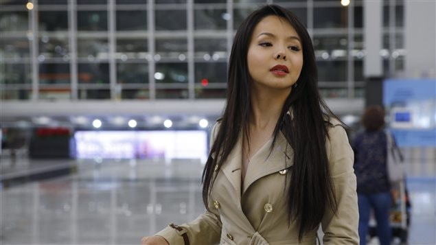 Canada's Miss World contestant Anastasia Lin poses for photographers after she was denied entry to mainland China, in Hong Kong International Airport, Thursday, Nov. 26, 2015.