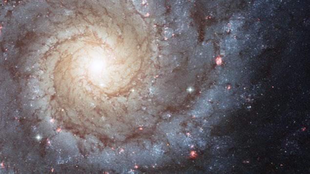 This Hubble Space Telescope photo of Messier 74 reminds us that spiral galaxies are some of the most beautiful and photogenic residents of the universe. Nearly 70 percent of the galaxies closest to the Milky Way are spirals. New research finds that spiral arms are self-perpetuating, persistent, and surprisingly long lived. Image released April 2, 2013.