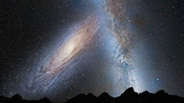 An illustration showing the predicted merger of our Milky Way galaxy with the neighboring Andromeda galaxy. In this image, representing Earth's night sky in 3.75 billion years, Andromeda, left, fills the field of view and begins to distort the Milky Way with tidal pull.
