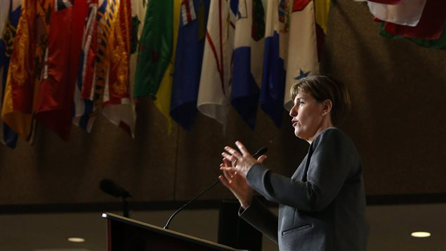 International Development Minister Marie-Claude Bibeau holds a news conference to announce $100 million in humanitarian funding to the United Nations High Commissioner for Refugess to help respond to needs in shelter, protection and health for refugees affected by the Syrian crisis, in Ottawa on Thursday, Nov. 26, 2015. THE CANADIAN PRESS/Fred Chartrand
