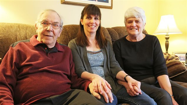 Janice Martell with her father, now suffering from Parkinson's, and her mother Elaine Hobbs. Workman's compensation would help to cope with the affliction but government agencies reject the claim of damage from aluminium.