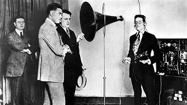 Famous heavyweight boxer Jack Dempsey speaks into the microphone at radio CFCF in 1922 during a stop in Montreal