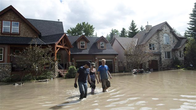 Residents waded through flood waters in the western city of Calgary on June 24, 2013. The government of the province of Alberta called the flood its worst natural disaster and pegged the cost at $6-billion.