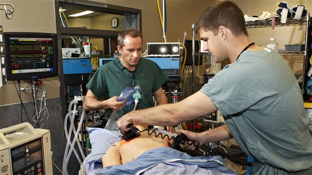 CSA Astronauts David Saint-Jacques (left) and Jeremy Hansen during trauma response training at McGill University's Medical Simulation Centre in Montreal, Quebec.