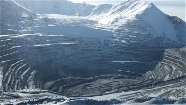Kumtor mine site, with glacier at top. Kumtor has to remove thousands of tons of ice per day to keep it's operations from being overrun. Global warming has created a glacial lake higher up which threaten to breach and flood a huge toxic tailings pone