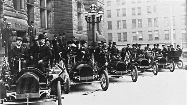 A row of Russell motor cars in front of Toronto city hall in 1909. Tommy Russell is seated in the driver's seat of the first car.