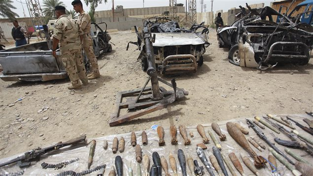 Iraqi security forces display vehicles, weapons and ammunition confiscated from ISIS in June 2014.