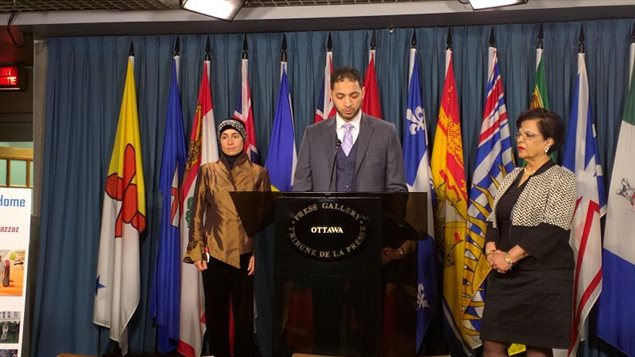 Ahmad Attia (C) speaking at a press conference in Ottawa on Dec. 10, 2015, with Senator Mobina Jaffer (R) and family friend Nadia Abu-Zahra (L).