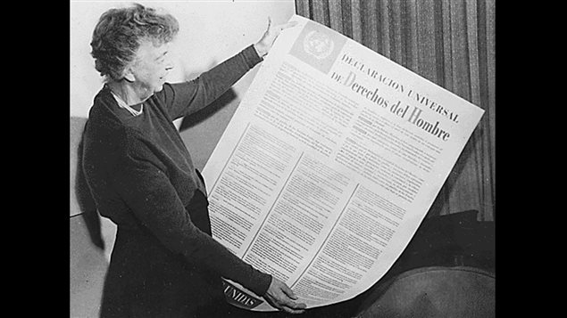 circa 1949: Eleanor Roosevelt holding a copy of the UN Universal Declaration of Human Rights