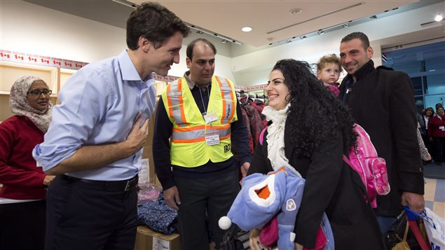 Canada's Prime Minister Justin Trudeau went to the airport in Toronto in December 2015 to welcome Syrian refugees.