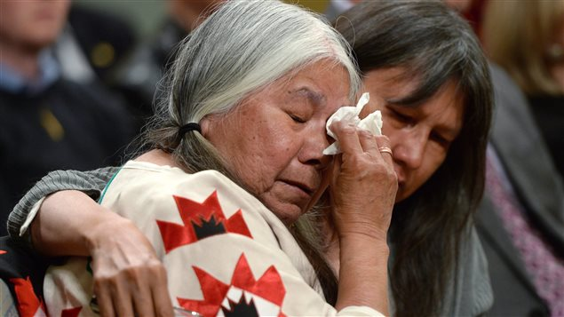 Residential school survivor Lorna Standingready is comforted by a fellow survivor in the audience during the closing ceremony of the Indian Residential Schools Truth and Reconciliation Commission, at Rideau Hall in Ottawa on Wednesday, June 3, 2015.