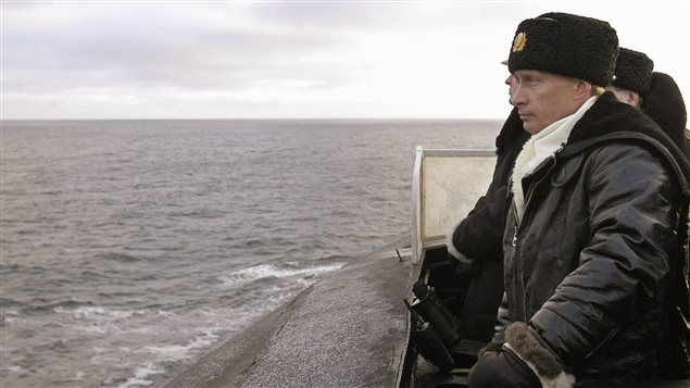 Russian President Vladimir Putin observes from aboard the submarine *Archangelsk* during exercises in the Barents sea near Severomorsk February 17, 2004.
