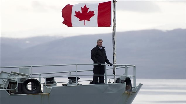 Former Canadian Prime Minister Stephen Harper stands on the bow of the HMCS Kingston as it sails in the Navy Board Inlet Sunday August 24, 2014.