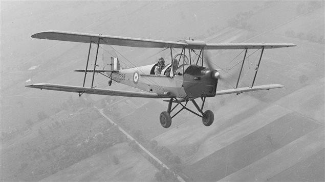 A Tiger Moth flies out of No. 1 Elementary Flight Training School at RCAF Malton, Ontario. Almost all of the pilots under the British Commonwealth Air Training Plan in Canada began their flight training on Tiger Moths