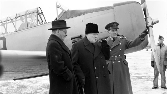 British Prime Minister Winston Churchill (centre) visits the British Commonwealth Air Training Plan school at RCAF Uplands, Ontario, in December 1941 with Canadian Air Minister C.G. Power (left) and Wing Commander W.R. MacBrien.