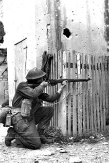 Canadian rifleman in Ortona December 1943. As fighting in the street became too deatly with Germans well sighted in, Canadians developed a tactic called -mouseholing- blowing holes through walls to get to the next house in vicious house to house fighting.