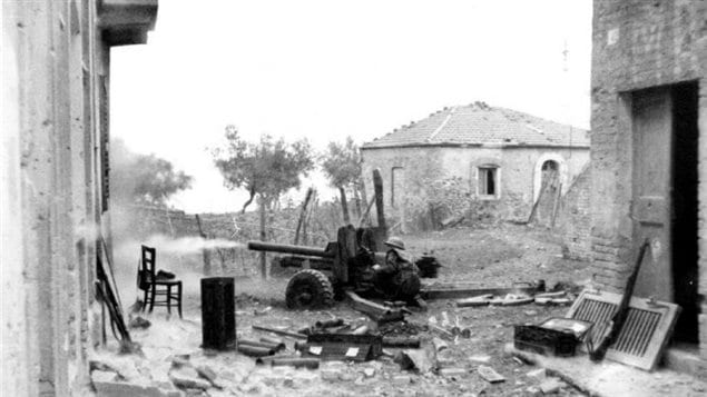 Canadian 6-pounder anti-tank gun engages in direct fire in Ortona 21 December 1943