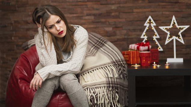 Une femme avec un air triste.