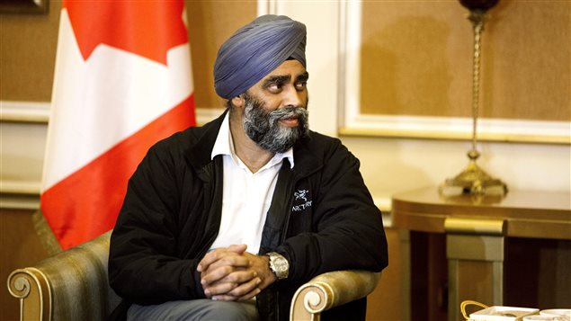 Canadian Defence Minister Harjit Sajjan is welcomed by Karim Sinjari, Interior Minister of the Kurdish Regional Government (KRG), not pictured, upon his arrival to Irbil, northern Iraq, Sunday, Dec. 20, 2015.