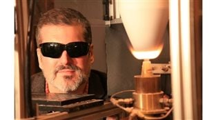 Professor J Bergthorson (PhD) with an aluminium flame. The dark glasses are for eye protection since the aluminum flame is so bright (because it burns at 3000 degrees C!