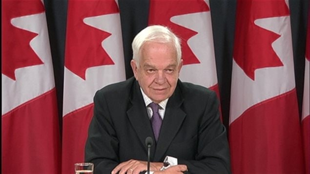 Immigration Minister John McCallum says more than 10,000 Syrian refugees will have passed medical exams and other requirements to be certified as permanent residents of Canada by the end of the year — but they may not all be on Canadian soil.