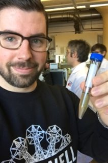 Halifax bar-owner Chris Reynolds in the Dalhousie University lab with a vial of Alexamder keith's beer estimated to be about 125 years old