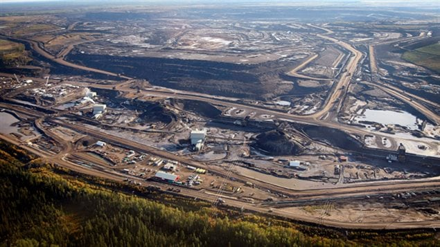 This file photo from Sept. 19, 2011, shows an aerial view of an oil sands mine facility near Fort McMurray, Alberta.
