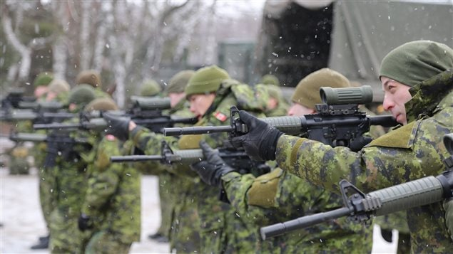 Canadian soldiers practice their shooting skills during Operation UNIFIER, Canada's military training mission to Ukraine, at the International Peacekeeping and Security Centre (IPSC) in Starychi, Ukraine on December 30, 2015.