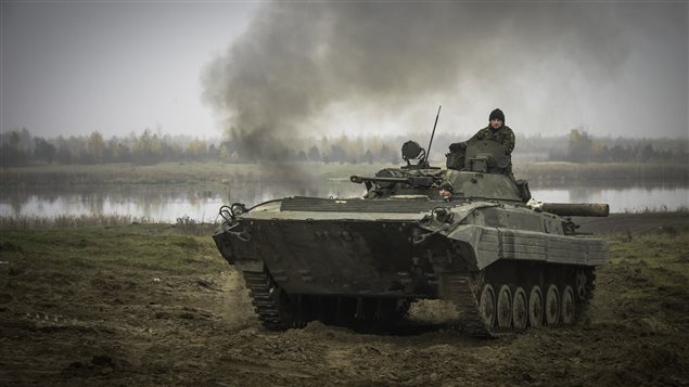 Ukrainian soldiers manoeuvre a BMP-2 armoured vehicle on a live range at the International Peacekeeping and Security Centre (IPSC) during Operation UNIFIER in Starychi, Ukraine on November 6, 2015.