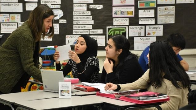 Newly-arrived teens are learning English now at Queen Elizabeth School in Edmonton, and are very likely to seek post-secondary education.