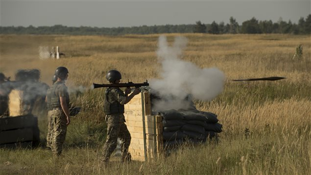 A member of the Ukrainian Forces fires a grenade launcher on a firing range during Operation UNIFIER at the International Peacekeeping and Security Centre (IPSC) in Starychi, Ukraine, on September 16, 2015.