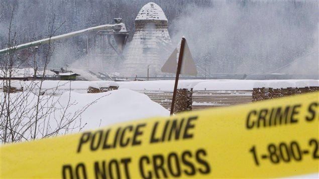 Smoke rises from the Babine Forest Products mill on January 12, 2012. This one of two explosions at British Columbia sawmills killed two workers and injured 20.