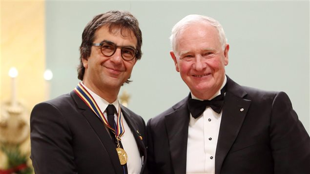 Atom Egoyan, film and stage director visual artist and screenwriter, receives the 2015 Lifetime Artistic Achievement Award at the Governor General's Performing Arts Awards from Governor General David Johnston (right), Friday May 29, 2015 in Ottawa.