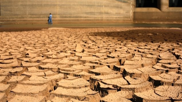 A huge dam in Brazil holds back almost no water, only died mud, The huge city of Sao Paulo Brazil almost ran out of water in the hottest summer on record