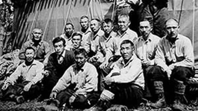 A group of interned Japanese Canadian men pose at a road camp in western Canada in March of 1942.