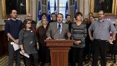 Les députés Dave Turcotte et Françoises David, respectivement du PQ et de QS, ont dénoncé la réforme de l'aide sociale à l'Assemblée nationale.