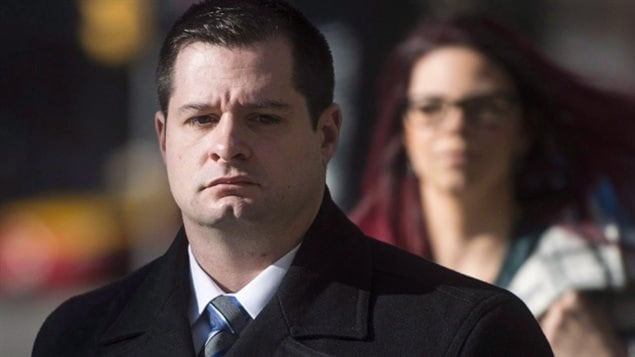 Const. James Forcillo, charged in the shooting death of Sammy Yatim, walks into court in Toronto, Wednesday, Nov, 25, 2015. On Monday, a jury found Forcillo guilty of attempted murder but not guilty of second-degree murder