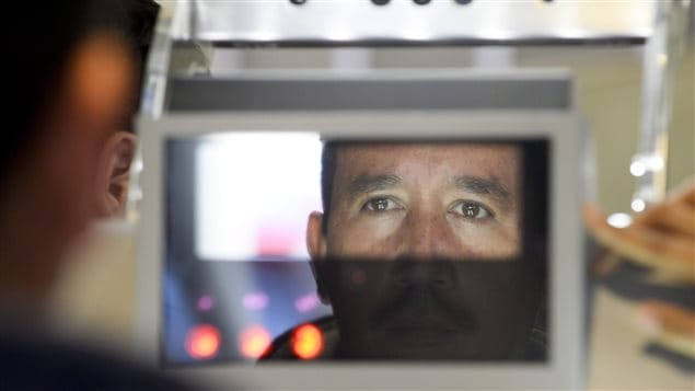 Facial features and eyes are scanned at a biometric kiosk in San Diego, California. Biometrics are also used by customs agents in Canada.