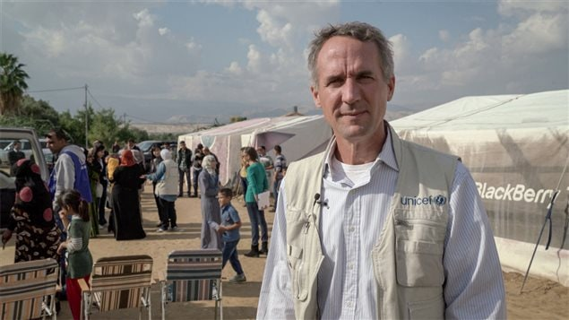 Robert Jenkins during a field visit to a UNICEF mobile nutrition outreach at an informal settlement of Syrian refugee families in Southern Jordan – 2015