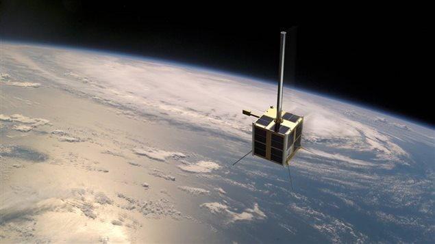 AISSat-2, le satellite canadien au-dessus de l'Arctique norvégien. Favoriser les occasions d'affaires, le commerce et l'investissement au sein de la région Arctique dépend de plus en plus de la surveillance et du regard-espion des satellites. Photo : Kongsberg Satellite Services