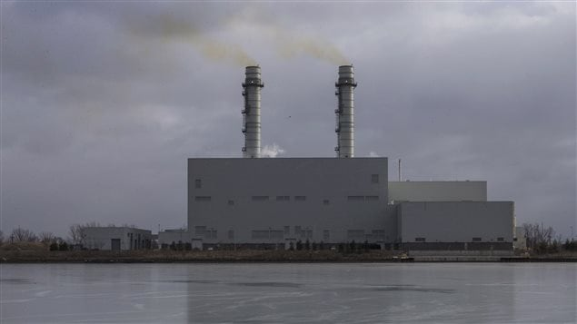 Discharge is pictured coming out of the chimneys of the Portands Energy Centre in Toronto, on Tuesday, January 19, 2016.